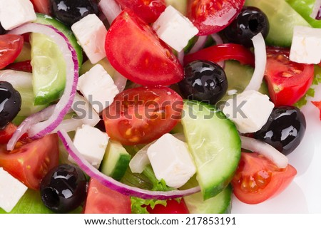 Greek salad in plate. Isolated on a white background.  - stock photo