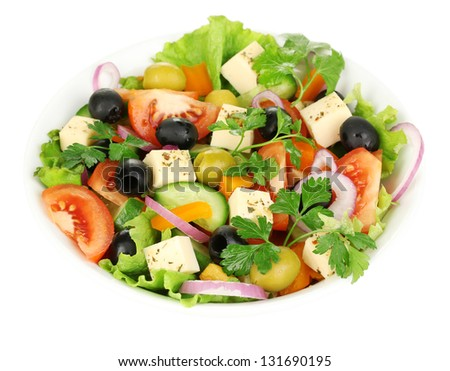 Greek salad in plate isolated on white - stock photo