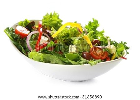 Greek salad in stylish white bowl, isolated on white.  Lovely goat's cheese, kalamata olives, cherry tomatoes, red onion, bell peppers and mixed lettuce. - stock photo
