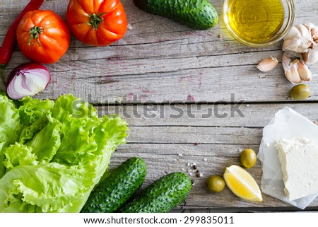 Greek salad ingredients, rustic wood background, top view - stock photo