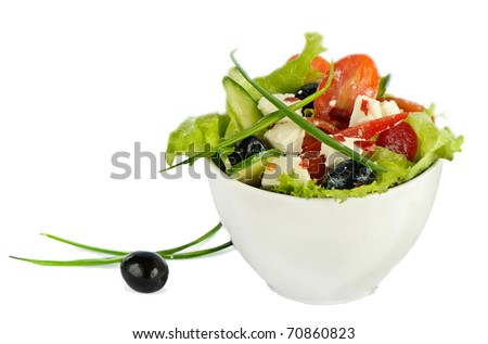 Greek salad isolated on white - stock photo