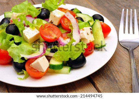Greek salad on a wooden table