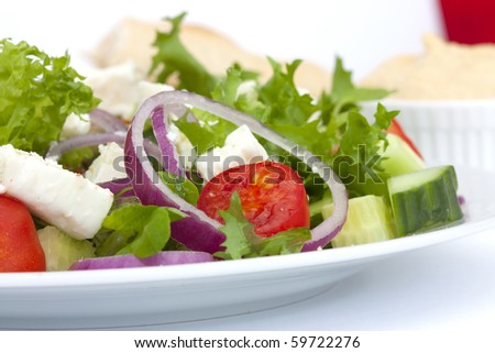 greek salad shot in natural daylight iwith white background