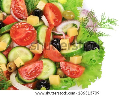 Greek salad with cheese. Isolated on a white background.