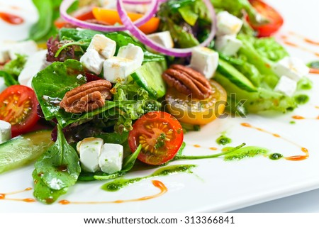 Greek salad with  cheese , tomatoes and nuts