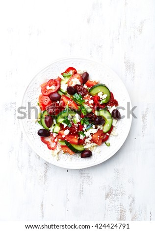 Greek Salad with Dried Tomatoes and Spring Onion - stock photo