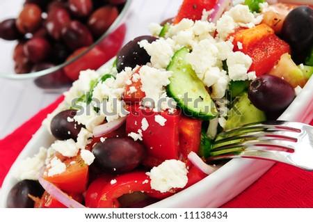 Greek salad with feta cheese and black kalamata olives - stock photo