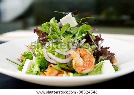 Greek salad with feta cheese and smoked shrimp - stock photo