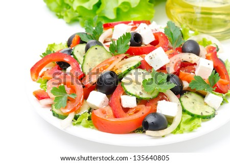 Greek salad with feta cheese, olives and vegetables isolated on white background