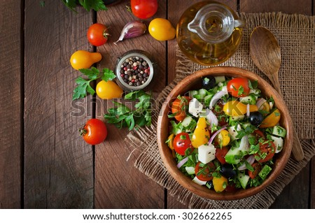Greek salad with fresh vegetables, feta cheese and black olives. Top view - stock photo