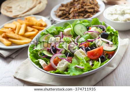 Greek Salad with Gyros and Fries - stock photo