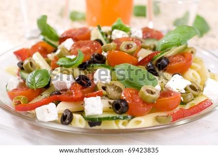 Greek salad with pasta - stock photo
