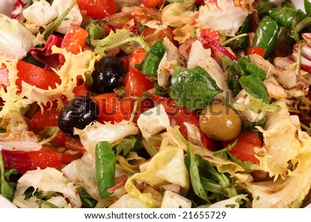 Greek salad with tomato, mozzarella cheese, onions, olives