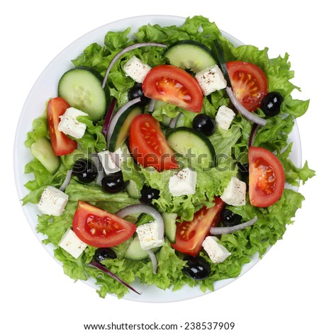 Greek salad with tomatoes, Feta cheese and olives in bowl from above isolated on a white background