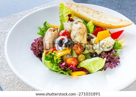 Greek Seafood Salad bowl cuisine - stock photo
