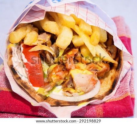 Greek specialty with roasted meats - giros - stock photo