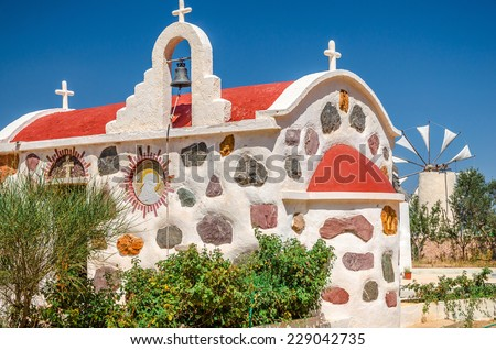 Greek stone church on Lassithi plateau in Crete  - stock photo