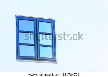Greek style blue old window on white wall background architecture detail