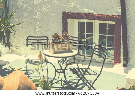 greek style furniture. Greek Style Terrace With Decorative Flower Pots And Garden Furniture At Santorini, Greece O
