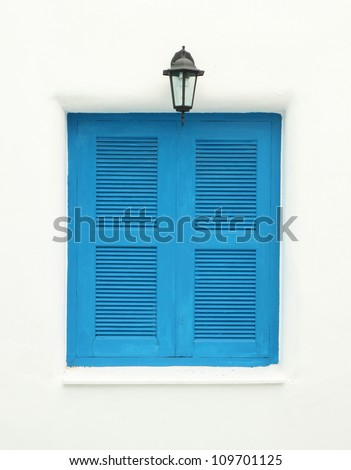 Greek Style windows and lamp on white wall - stock photo