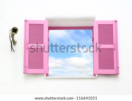 Greek style windows with cctv and blue sky view - stock photo