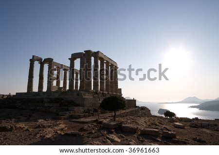 greek temple of Poseidon on coast of cape Sounion in backlits - stock photo