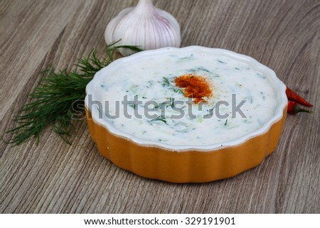 Greek traditional cuisine - Tzatziki with cucmber and dill - stock photo