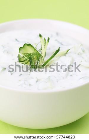 Greek Tzatziki with cucumbers, dill and garlic, known as tarator or snezhanka in Bulgaria or zaziki in Turkey. Shallow DOF - stock photo
