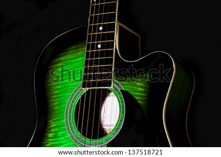 green acoustic guitar body.sunburst.black background - stock photo