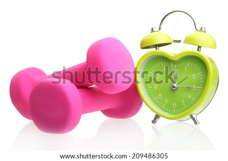 Green alarm clock heart shape and pink dumbbells isolated on white background. - stock photo