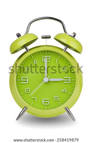 Green alarm clock with the hands at 3 am or pm isolated on a white background. One of a set of 12 images showing the top of the hour starting with 1 am / pm and going through all 12 hours - stock photo