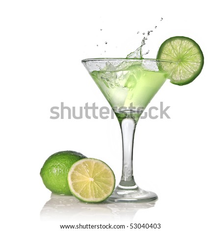 Green alcohol cocktail with splash and green lime isolated on white - stock photo