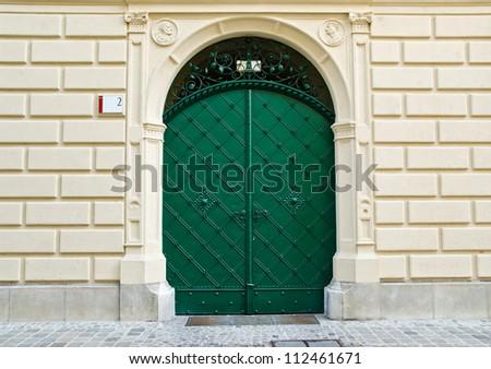 Green ancient front door - stock photo