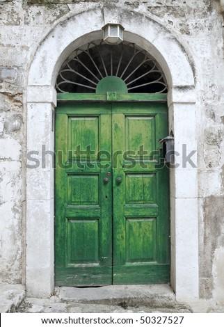 Green ancient frontdoor. - stock photo