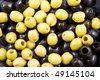 Green and black fresh olives used as background - stock photo