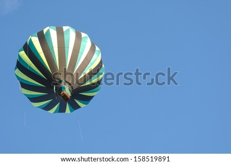 Green and Black Hot Air Balloon - stock photo
