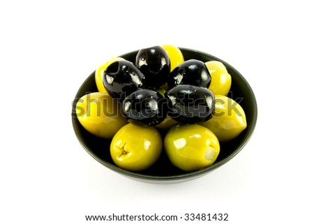 Green and black olives in a small black bowl on a white background