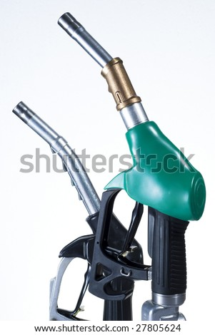 Green and black refueling pipes for gas - stock photo