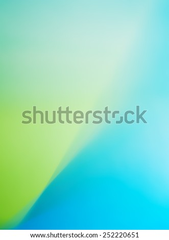 green and blue abstract defocused colorful blurred background pastel gradient - stock photo