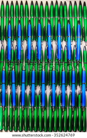Green and blue ball pens as a background. - stock photo