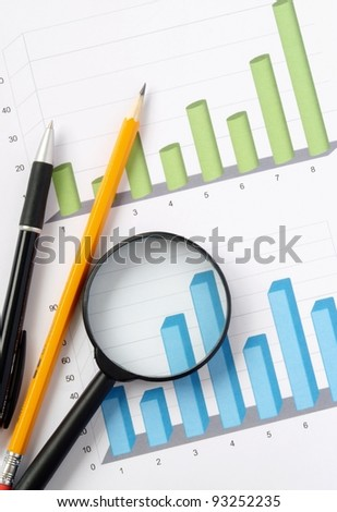 green and blue chart and office objects - stock photo