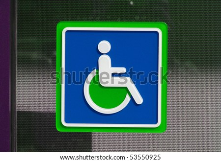green and blue handicap sign