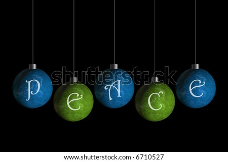 green and blue ornaments that spell peace - stock photo