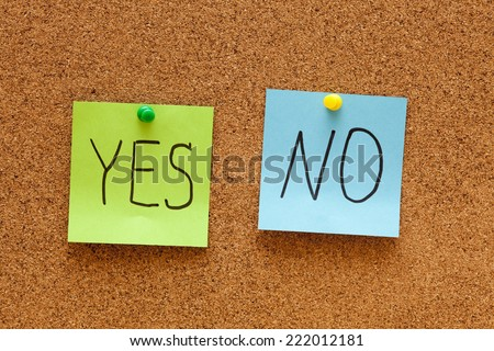 "Green and blue paper with ""Yes"" and ""No"" words on corkboard (bulletin board). - stock photo"