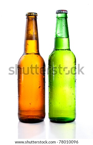 Green and brown beer bottle with drops drink without label on a white background - stock photo