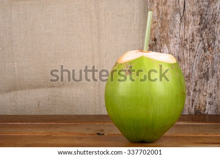 Green and Brown Coconuts - stock photo