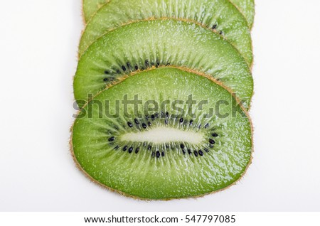 Green and Brown Slices of Kiwi on White