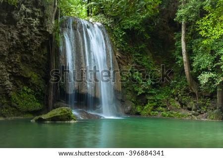 Green and clean waterfall , Erawan waterfall , Loacated Kanjanaburi Province , Thailand - stock photo