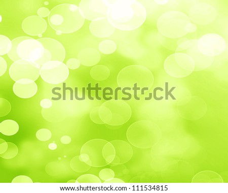 Green and fresh background with soft bokeh effects and white overlapping circles - stock photo