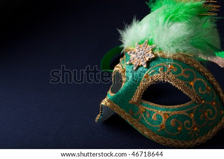 green and gold mask on dark  background